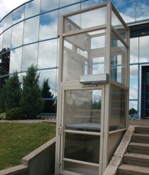 outdoor photo of savaria v-1504 vertical platform lift elevator outside building