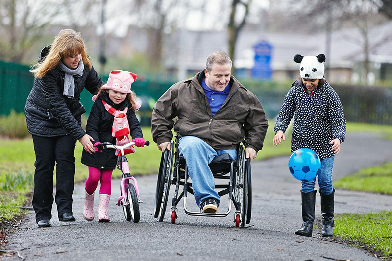 disabled-man-with-family