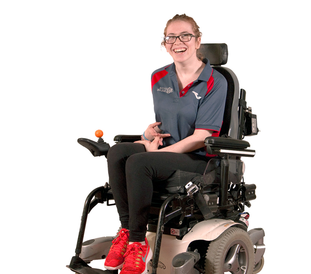 young woman sitting on a electric wheelchair