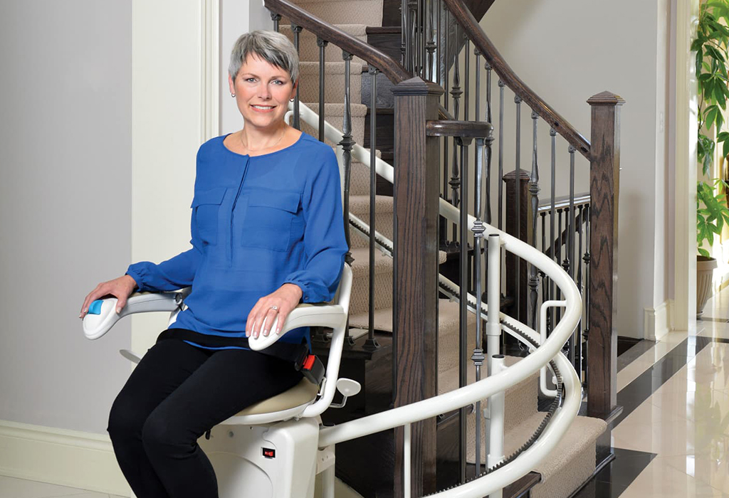 old woman sitting on her curved stairlift