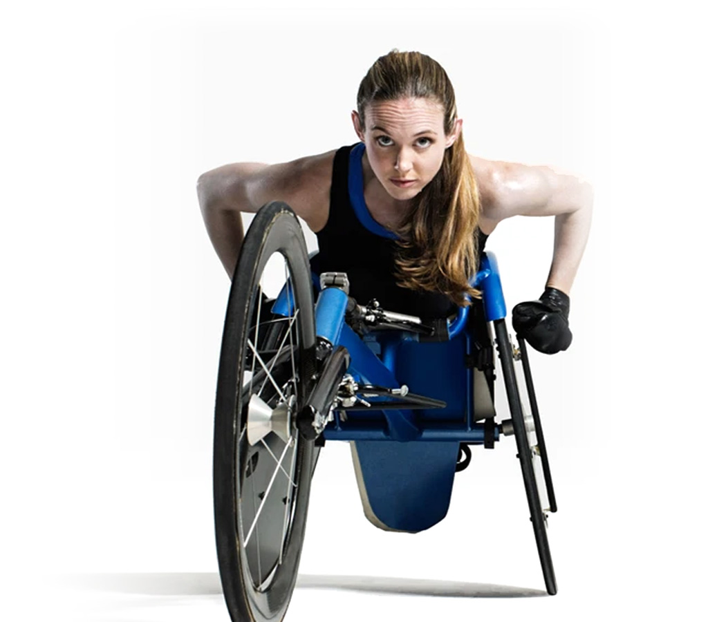 athletic woman with a disability pushing her wheelchair