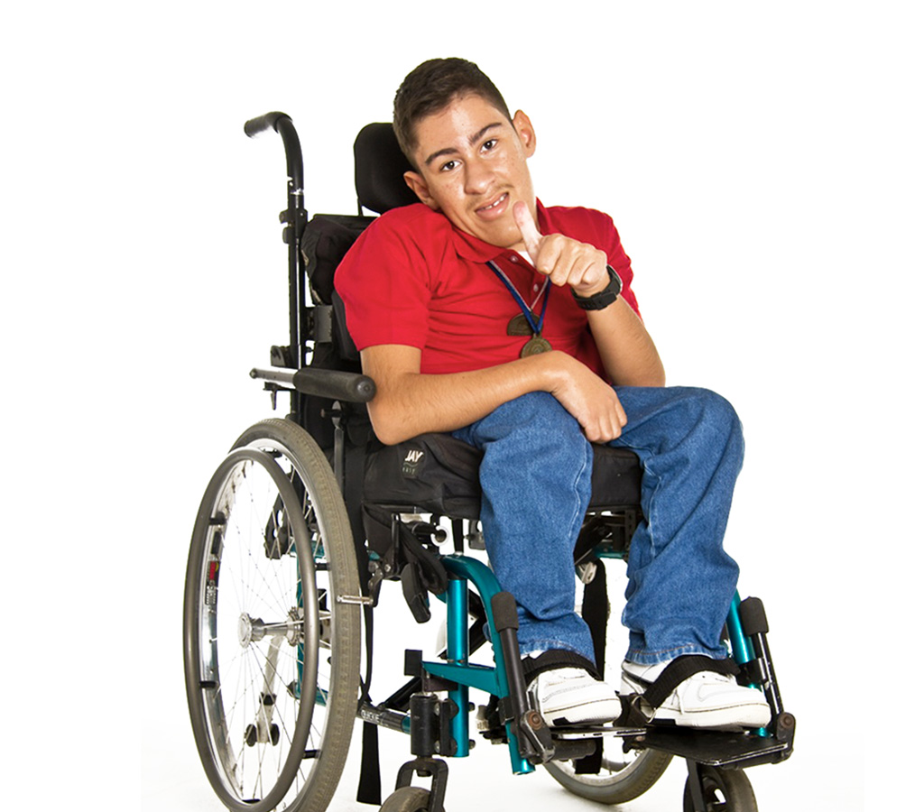 teenager with a disability smiling on his wheelchair