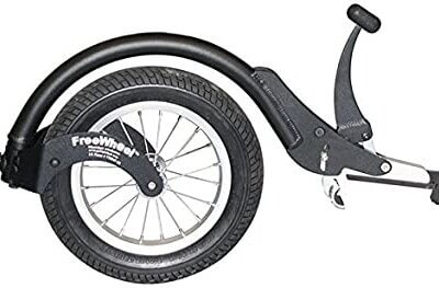 FreeWheel add-on for wheelchair with white background