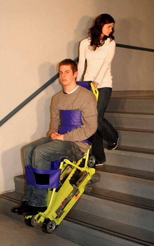 woman using the powertrac chair to pull up a guy on the stairs