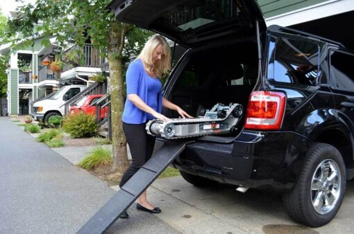woman packing her stairtrac on her SUV