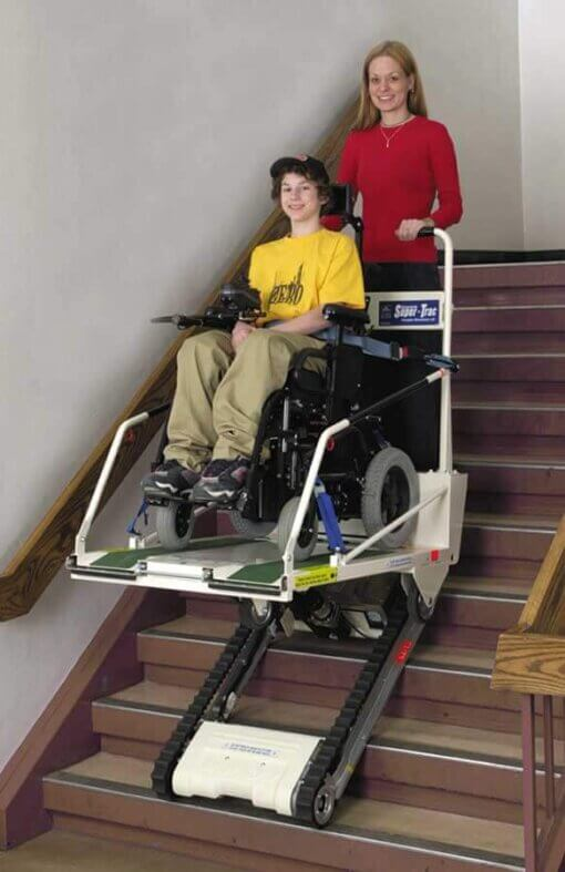 Woman using the Garaventa Super Trac lift to help her son through the stairs