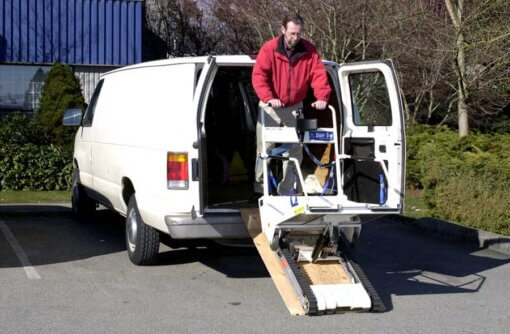 Male unloading the Garaventa Super Trac from a van